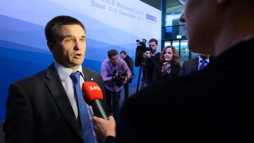 Ukrainian Foreign Minister Pavlo Klimkin speaks during a press conference at  the  Organization for Security and Cooperation in Europe (OSCE) ministerial meeting at the Basel Exhibition Center, in Basel, Switzerland, Friday, Dec. 5, 2014.  (AP Photo/Keystone,Laurent Gillieron)