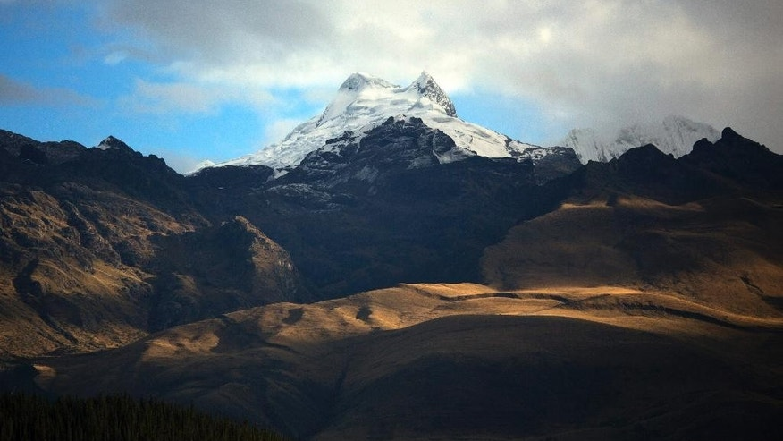 The Vallunaraju mountain stands high in the Andes, early morning in Huaraz, Peru, Wednesday, Dec. 3, 2014. Peru's glaciers have lost more one-fifth of their mass in just three decades, and the 70 percent Peru's 30 million people who inhabit the country's Pacific coastal desert, depend on glacial runoff for hydropower and to irrigate crops, meaning their electricity and long-term food security could also be in peril. Higher alpine temperatures are killing off plant and animal species in cloud forests and scientists predict Pacific fisheries will suffer. (AP Photo/Rodrigo Abd)