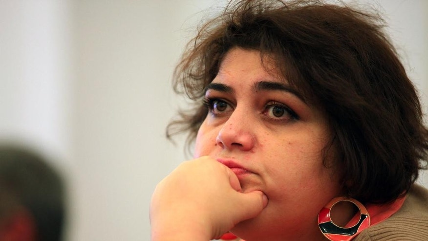 This photo taken Sunday, March 2, 2014, shows Azerbaijani Khadija Ismayilova, a reporter for Radio Free Europe/Radio Liberty, in Baku, Azerbaijan. Azerbaijan detained Khadija Ismayilova, a prominent investigative journalist, on Friday whose reporting has often featured the business dealings of top politicians in the country. (AP Photo/Aziz Karimov)