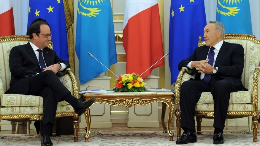 Kazakh President Nursultan Nazarbayev, right, and French President Francois Hollande speak during their meeting in Astana, Kazakhstan, Friday, Dec. 5, 2014.  (AP Photo/Sergei Bondarenko, Presidential Press Service)