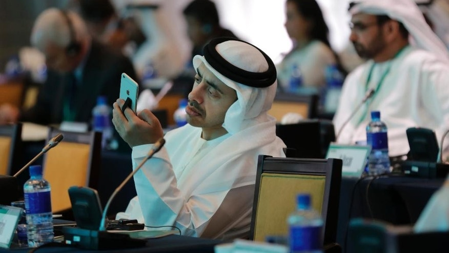 "United Arab Emirates Foreign Minister Sheik Abdullah bin Zayed Al Nahyan checks his phone during the 10th International Institute for the Strategic Studies in Manama, Bahrain, Saturday, Dec. 6, 2014. Britain's top diplomat says his nation has signed a deal with the Gulf Arab nation of Bahrain to bolster the United Kingdom's military presence in the region. Foreign Secretary Philip Hammond announced the deal Saturday at a security conference in the Bahraini capital, Manama, where he assured Gulf allies that ""your security concerns are our security concerns."" (AP Photo/Hasan Jamali)"