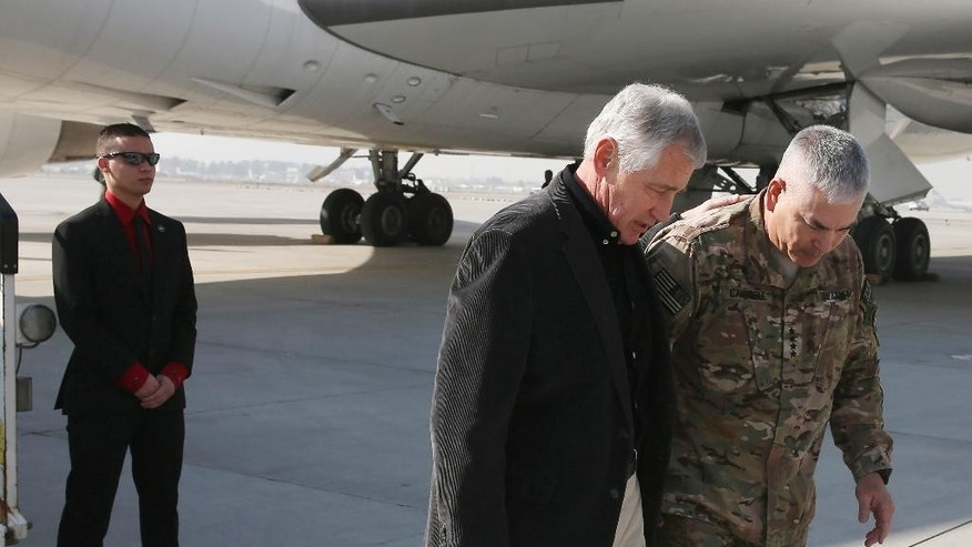 "U.S. Secretary of Defense Chuck Hagel is greeted by Gen. John F. Campbell (R) after arriving on Saturday, Dec. 6, 2013 in Kabul, Afghanistan. Speaking in Afghanistan Saturday, Dec. 6, 2014, Secretary Hagel said American photojournalist Luke Somers ""and a second non-U.S. citizen hostage were murdered"" by al-Qaida militants during a failed U.S. rescue attempt. (AP Photo/Mark Wilson, Pool) POOL PHOTO"