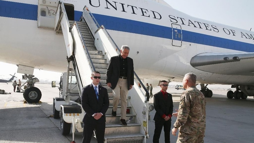 "U.S. Secretary of Defense Chuck Hagel is greeted after arriving on Saturday, Dec. 6, 2013 in Kabul, Afghanistan. Speaking in Afghanistan Saturday, Dec. 6, 2014, Secretary Hagel said American photojournalist Luke Somers ""and a second non-U.S. citizen hostage were murdered"" by al-Qaida militants during a failed U.S. rescue attempt. (AP Photo/Mark Wilson, Pool) POOL PHOTO"