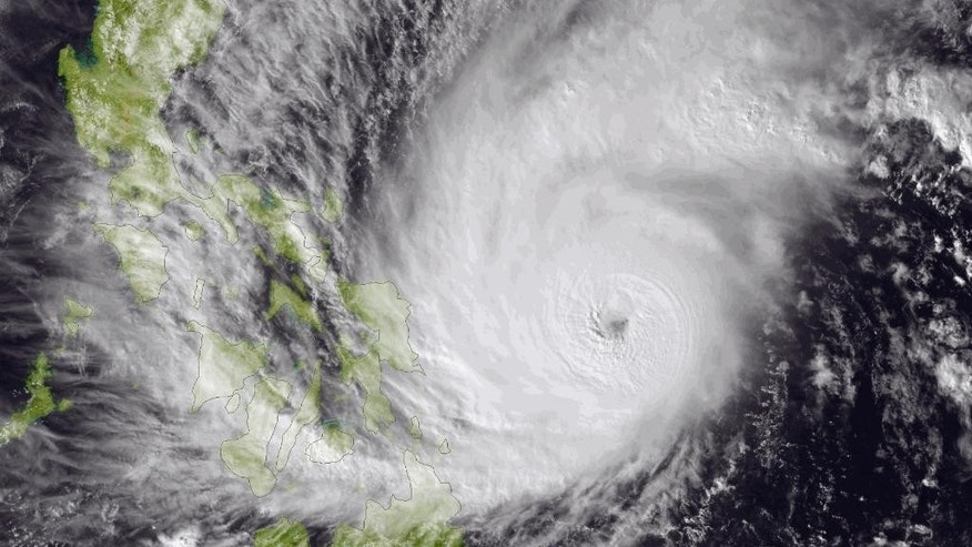 This image made available by the National Oceanic and Atmospheric Administration (NOAA) shows Typhoon Hagupit on Friday, Dec. 5, 2014, as it approaches the Philippines. The ferocious and dangerously erratic typhoon is blowing closer to the Philippines as differing forecasts about its path prompt a wide swath of the country to prepare for a weekend of destructive winds and rain. (AP Photo/NOAA)