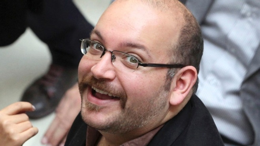 April 11, 2013: Jason Rezaian, an Iranian-American correspondent for the Washington Post smiles as he attends a presidential campaign of President Hassan Rouhani in Tehran, Iran.(AP)