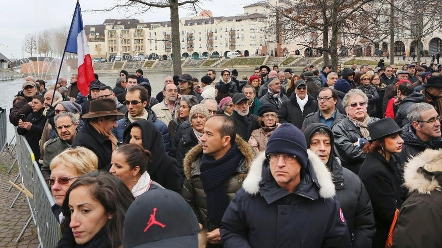 People gather for a protest against anti-Semitism, in Creteil, east of Paris, Sunday Dec. 7, 2014, An attack on a French Jewish couple this week, had revived worries about long-simmering anti-Semitic sentiment in France. The number of anti-Semitic incidents in France has grown 91 percent this year compared to last year, said Roger Cukierman, head of France's leading Jewish organization, CRIF. (AP Photo/Remy de la Mauviniere)
