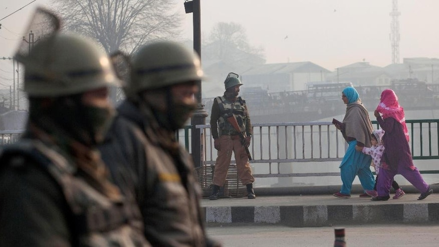 Indian paramilitary soldiers stand guard at a temporary checkpoint in Srinagar, Indian controlled Kashmir, Saturday, Dec. 6, 2014. Security was beefed up the day after militants in the disputed territory of Kashmir attacked an Indian army camp, triggering a fierce gun-battle that left 11 Indian soldiers and six suspected assailants dead, officials said. (AP Photo/Dar Yasin)