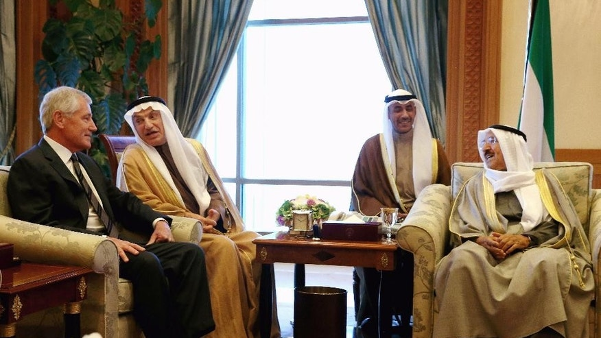 U.S. Secretary of Defense Chuck Hagel, left, meets with Emir of Kuwait Sheik Sabah Al Ahmad Al Sabah, (R) at the Kuwaiti Seif Palace, Monday, Dec. 8, 2014. Also pictured is Sheik Nawaf Al-Ahmad Al-Jaber Al-Sabah, (2ndL) Crown Prince of Kuwait and Deputy Commander of the Military of Kuwait. (AP Photo/Mark Wilson, Pool)