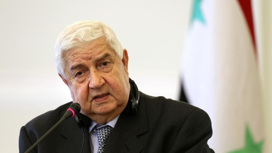 "Syrian Foreign Minister Walid al-Moallem speaks during a joint press conference with his Iranian counterpart Mohammad Javad Zarif in Tehran, Iran, Monday, Dec. 8, 2014. Russia on Monday demanded an explanation for Israeli airstrikes on two areas near Damascus, while the Syrian and Iranian foreign ministers called it an act of aggression that proves Israel was ""in the same trench"" with extremist groups fighting the Syrian government. (AP Photo/Ebrahim Noroozi)"