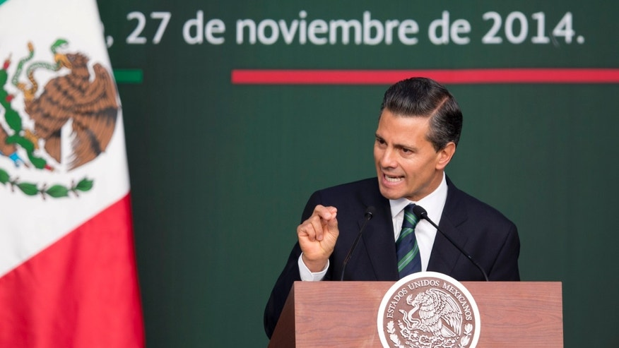 Mexico's President Enrique Pena Nieto speaks during a ceremony at the National Palace in Mexico City, Thursday, Nov. 27, 2014.  Mexico's president announced a new anti-crime plan that includes proposals for a nationwide ID, giving Congress the power to dissolve corrupt municipal government and fold their often-corrupt local police forces under the control of the countrys 31 state governments. The plan would also streamline the complex divisions between federal, state and local offenses. At present, some local police refuse to act to prevent federal crimes like drug trafficking.  The plan would focus first on four of Mexicos most troubled states, Guerrero, Michoacan, Jalisco and Tamaulipas. It would also send more federal police and other forces to those states. (AP Photo/Eduardo Verdugo)