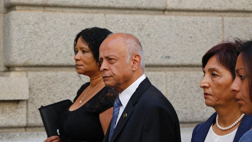 Prakash Dewani, center, the father of British businessman Shrien Dewani, arrives at the high court in the city of  in Cape Town, South Africa, Monday, Dec. 8, 2014. A British man Shrien Dwani accused of killing his wife Anni while they were on honeymoon in Cape Town was acquitted of murder on Monday after a South African judge concluded that the prosecution's case did not have sufficient evidence. Shrien Dewani promptly descended stairs leading out of the courtroom following the not guilty ruling by Cape Town High Court Judge Jeanette Traverso. (AP Photo/Schalk van Zuydam)