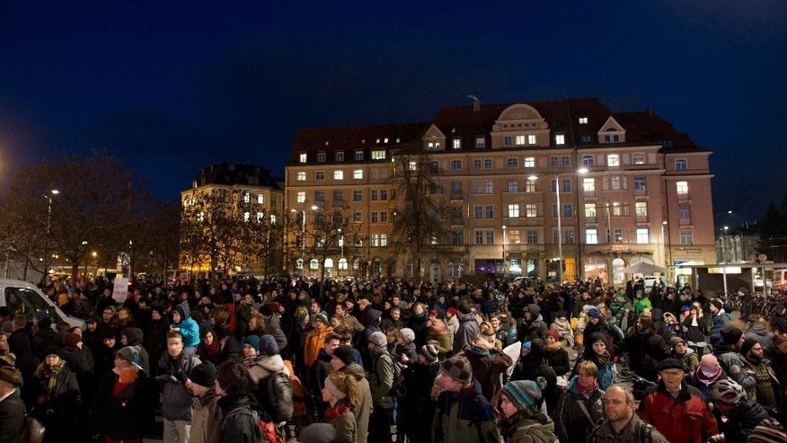 Members of an alliance against the rightist  Pegida  movement (Patriotic Europeans against the Islamization of the Christian Occident) gather  in Dresden , Germany,  Monday Dec. 8,  2014.  (AP Photo/dpa,Arno Burgi)