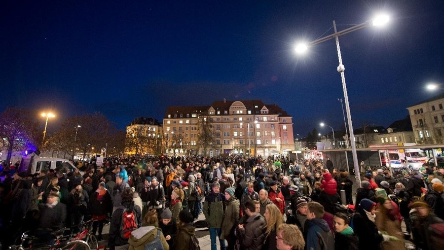 Participants of a demonstration  against a  far-right   movement  gather in Dresden, eastern Germany, Monday Dec. 8, 2014.   (AP Photo/dpa, Arno Burgi)
