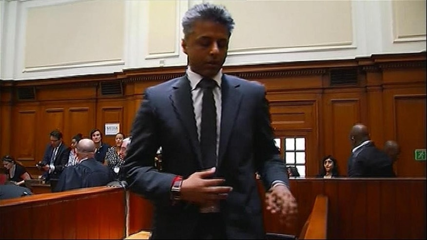 In this image taken from TV British businessman Shrien Dewan leaves the court in Cape Town South Africa after being acquitted of the murder of is wife Anni Monday Dec. 8, 2014.   Dwani was accused of killing his wife Anni while they were on honeymoon in Cape Town and was acquitted of murder  after  South African judge  Jeanette Traverso concluded that the prosecution's case did not have sufficient evidence. Shrien Dewani promptly descended stairs leading out of the courtroom following the not guilty ruling .  (AP Photo/Court Pool)