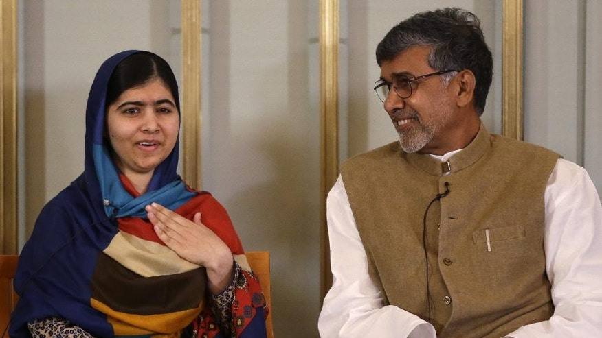 Joint-Nobel Peace prize winners Malala Yousafzai, left, and Kailash Satyarthi attend a press conference in Oslo, Norway, Tuesday, Dec. 9, 2014.  The Nobel Peace Prize will be presented to and shared between the youngest Nobel Prize winner ever, 17-year-old Taliban attack survivor Malala Yousafzai and Indian children's rights activist Kailash Satyarthi in a ceremony in Oslo on Wednesday. (AP Photo/Matt Dunham)