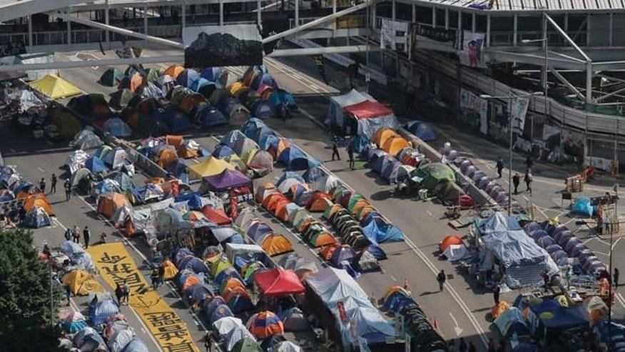 Dec. 9, 2014: Pro-democracy protesters' tents are seen at the occupied area outside government headquarters in Hong Kong. Hong Kong authorities and activists are set for one last showdown after the publication Tuesday of a court order authorizing the removal of barricades and tents blocking the Asian financial hub's streets for more than two months.