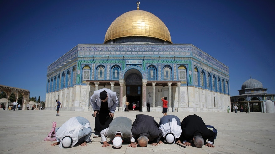Oct. 5, 2014: Palestinians from Gaza pray in front of the Dome of the Rock during their visit at the compound known to Muslims as Noble Sanctuary and to Jews as Temple Mount in Jerusalem's Old City.