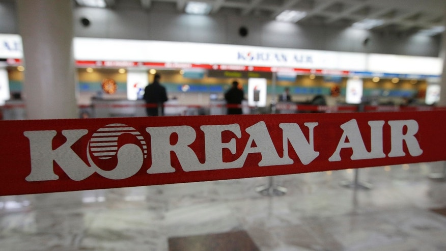 Dec. 9, 2014: A Korean Air logo is seen at its ticketing counter at Gimpo Airport in Seoul, South Korea
