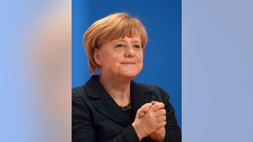Chancellor and chairwoman of the German Christian Democrats, CDU, Angela Merkel, thanks the delegates for standing ovations after her speech at the 27. party convention in Cologne, Germany, Tuesday, Dec. 9, 2014. (AP Photo/Martin Meissner)