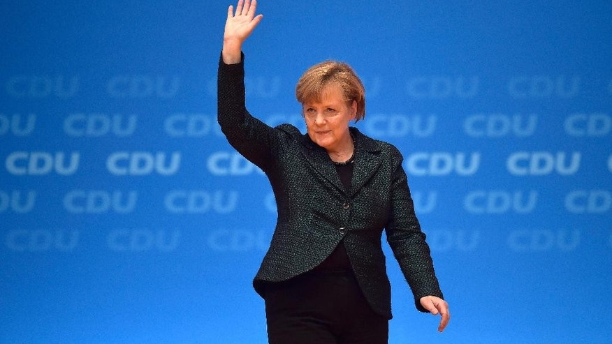 German Chancellor and chairwoman of the Christian Democrats, CDU, Angela Merkel, thanks the delegates for  standing ovations after her speech at the 27.  party convention in Cologne, Germany, Tuesday, Dec. 9, 2014. (AP Photo/Martin Meissner)