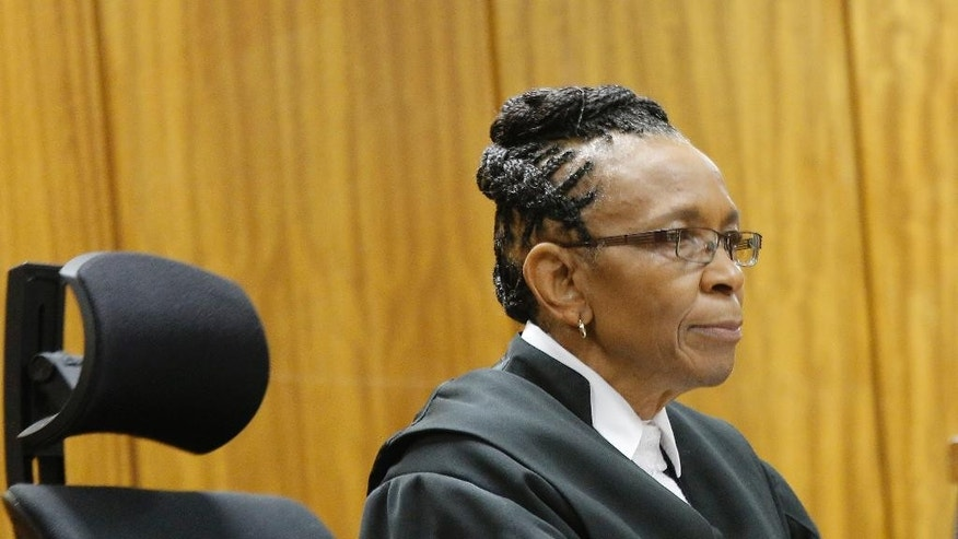 Judge Thokozile Masipa listens in court in Pretoria, South Africa, Tuesday, Dec. 9, 2014,  in the case against Oscar Pistorius, who was acquitted of murder for killing girlfriend Reeva Steenkamp. State prosecutor, Gerrie Nel  outlined his objections to the verdict and sentence against Pistorius, who was convicted of the lesser charge of culpable homicide and sentenced to a five year prison term in October by Masipa. (AP Photo/Kim Ludbrook, Pool)