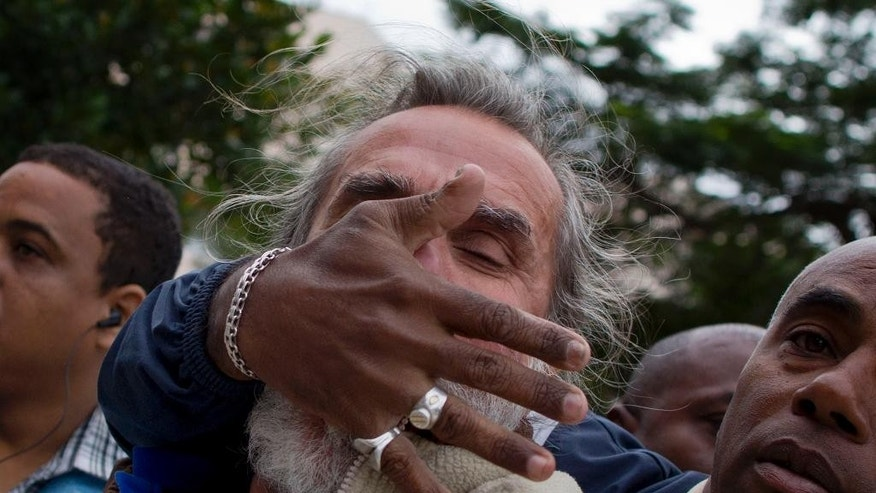 "An opposition activist is detained by Cuban security officers before the start of a march marking International Human Rights Day in Havana, Cuba, Wednesday, Dec. 10, 2014. The march was organized by the ""Damas de Blanco,"" or Women in White, a pro-democracy group of women activists. The demonstrators where picked up by the police as soon as they arrived, while hundreds of pro-government loyalist sang patriotic songs and slogans. (AP Photo/Ramon Espinosa)"
