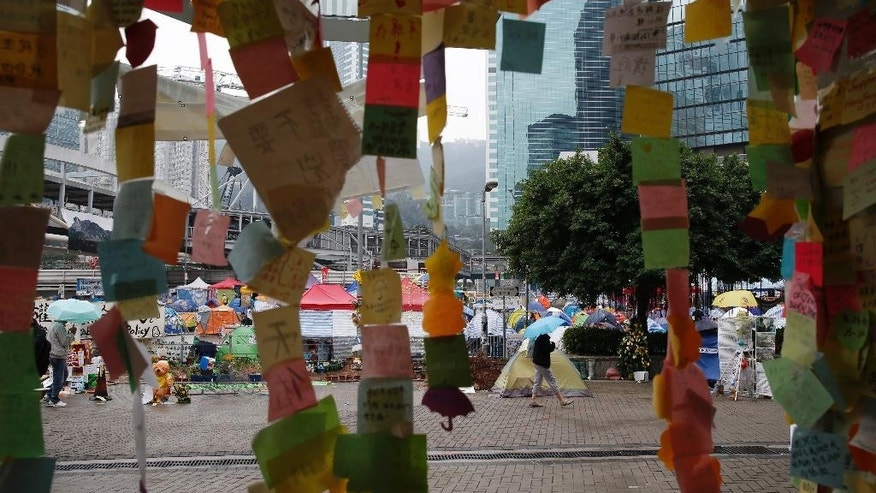Stickers with support messages are displayed at the occupied area outside government headquarters in Hong Kong Wednesday, Dec. 10, 2014. Police warned Hong Kong pro-democracy activists that they have until Thursday to leave a sprawling protest camp which has blocked traffic in the Chinese financial hub for more than two months. (AP Photo/Kin Cheung)