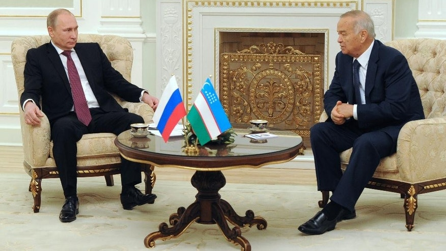 Russian President Vladimir Putin meets with his Uzbekistan's counterpart Islam Karimov, right, during a meeting in  Tashkent, Uzbekistan, Wednesday, Dec. 10, 2014. (AP Photo/RIA Novosti Kremlin, Mikhail Klimentyev, Presidential Press Service)