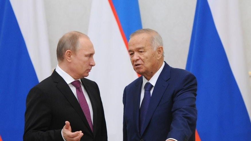Russian President Vladimir Putin speaks with his Uzbekistan's counterpart Islam Karimov, right, during a signing ceremony in  Tashkent, Uzbekistan, Wednesday, Dec. 10, 2014. (AP Photo/RIA Novosti Kremlin, Mikhail Klimentyev, Presidential Press Service)