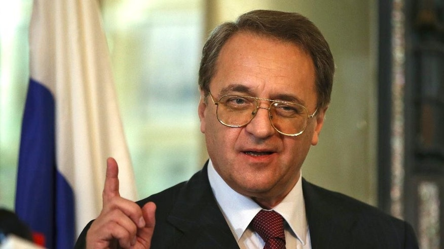 Russia's deputy Foreign Minister Mikhail Bogdanov, speaks with journalists after his meeting with the Lebanese Foreign Minister Gebran Bassil, at the Lebanese foreign ministry, in Beirut, Lebanon, Friday, Dec. 5, 2014. (AP Photo/Hussein Malla)