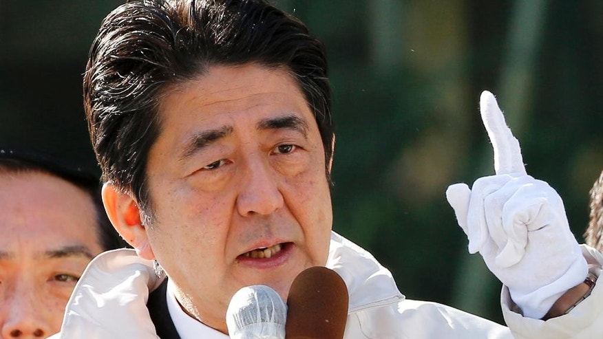 FILE - In this Sunday, Dec. 7, 2014 file photo, Japan's Prime Minister and President of ruling Liberal Democratic Party Shinzo Abe delivers a speech in support for his party's candidate during an election campaign for upcoming lower house election in Tokyo. A projected landslide victory for Japan's ruling party in national elections Sunday could give Prime Minister Shinzo Abe political breathing space to push forward with his long-held nationalist agenda. (AP Photo/Shizuo Kambayashi, File)