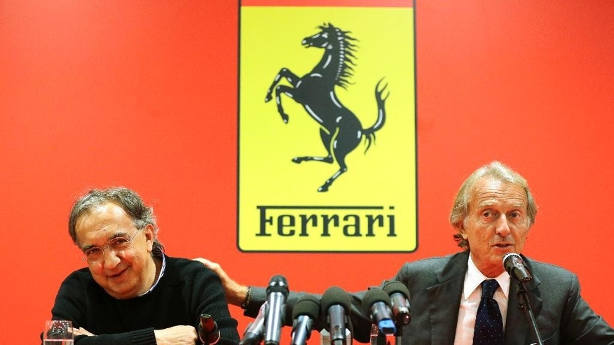 FILE - In this Sept. 10, 2014 file photo, Fiat-Chrysler CEO Sergio Marchionne, left, and then Ferrari President Luca Di Montezemolo attend a news conference in at the Ferrari headquarters in Maranello. Ferrari's sleek sports cars and souped-up Formula 1 racing machines have made the prancing horse logo among the world's most powerful brands. Now, as the company prepares for a public listing, it wants to cash in on the cachet. (AP Photo/Antonio Calanni, File)