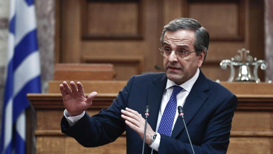 Greece's conservative Prime Minister Antonis Samaras,  addresses conservative party members of parliament, in Athens, Thursday, Dec 11, 2014. Samaras has called a vote in parliament this month for a new Greek president _ a ballot that could trigger and early general election. The prime minister said the collapse of his government could renew a risk to Greece's place in the euro. (AP Photo/Petros Giannakouris)