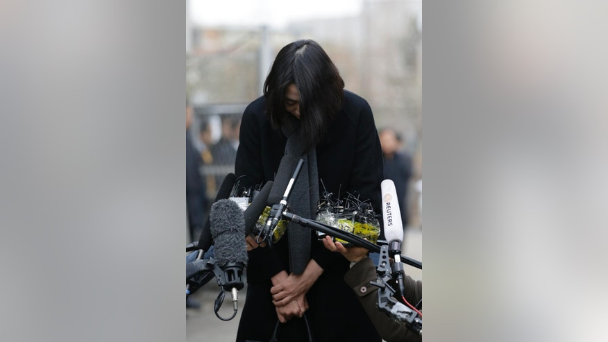 "Cho Hyun-ah, who was head of cabin service at Korean Air and the oldest child of Korean Air chairman Cho Yang-ho, bows upon her arrival for questioning at the Aviation and Railway Accident Investigation Board office of Ministry of Land, Infrastructure and Transport in Seoul, South Korea, Friday, Dec. 12, 2014. The chairman of Korean Air Lines Co. apologized Friday for the behavior of his adult daughter who delayed a flight in an incident now dubbed ""nut rage."" (AP Photo/Lee Jin-man)"