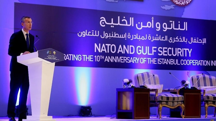 NATO Secretary General Jens Stoltenberg speaks during the opening of the NATO and Gulf Security conference in Doha, Qatar,  Thursday Dec. 11, 2014. (AP Photo/Osama Faisal)