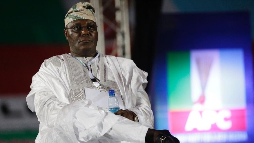 In this Wednesday, Dec. 10, 2014 photo, former Nigeria Vice President Atiku Abubakar, a presidential aspirant, waits to make a speech during the All Progressive Congress party convention in Lagos, Nigeria. (AP Photo/Sunday Alamba)