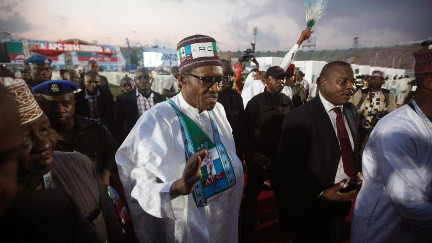 Former military leader Muhammadu Buhari, a presidential aspirant, waves after casting his vote during the All Progressive Congress party convention in Lagos, Nigeria Thursday, Dec. 11, 2014. (AP Photo/Sunday Alamba)