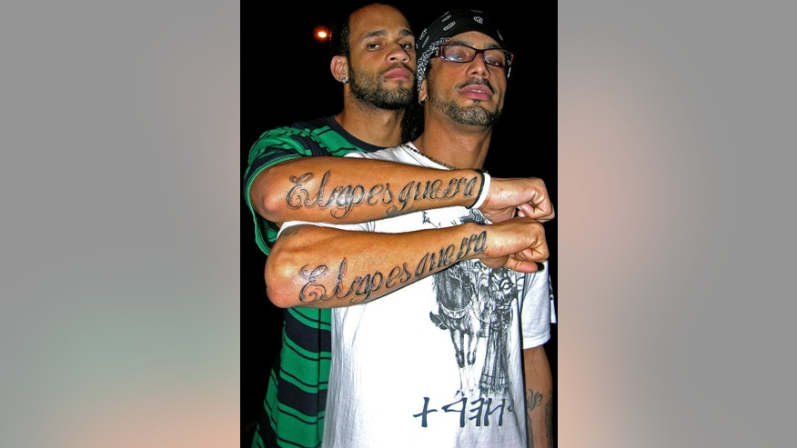 This 2008 photo provided by Melisa Riviere shows Bian Rodriguez, left, and Aldo Rodriguez, right, members of Los Aldeanos in Havana. Documents obtained by The Associated Press show that a U.S. agency infiltrated Cuba's hip-hop scene, recruiting unwitting rappers to spark a youth movement against the government. (AP Photo/Melisa Riviere)