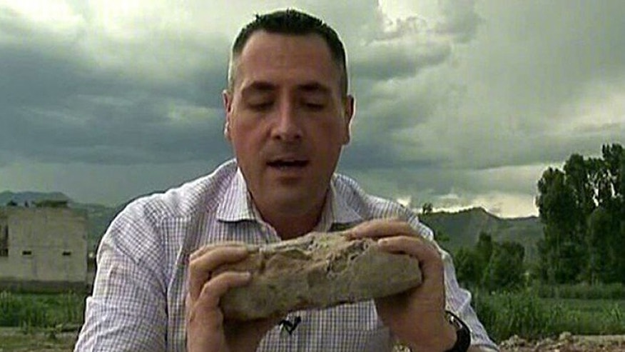 Di-Natale's reporting took him to Pakistan, where he is shown here holding a piece of Usama bin Laden's compound after Navy SEALs killed the terror boss. (Fox News Channel)