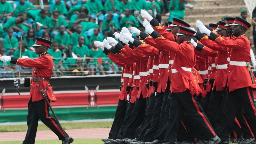 Kenyan Armed Forces, the 9th Battalion march during the Trooping of the Colour at the Nyayo National Stadium Nairobi, Kenya Friday, Dec. 12, 2014, during the 51st Madaraka Day or Independence from British Rule celebrations. (AP Photo Sayyid Azim)