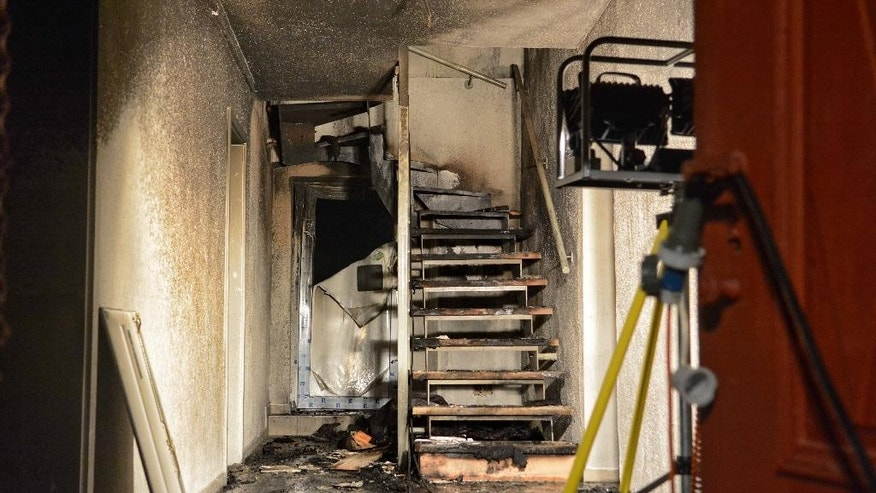 Inside view of a building after a fire was extinguished  in Vorra, Germany,  early Friday Dec. 12, 2014.  Police say arsonists are suspected of setting fires at three empty buildings in Bavaria that had been earmarked to serve as accommodation for asylum seekers. The fires broke out late Thursday evening in Vorra, near Nuremberg. Police said Friday that anti-foreigner slogans and swastikas were found daubed at one site. There was no one in the buildings at the time. Police say the blazes were extinguished quickly but one firefighter was slightly injured.  (AP Photo/dpa, ToMa/dpa)