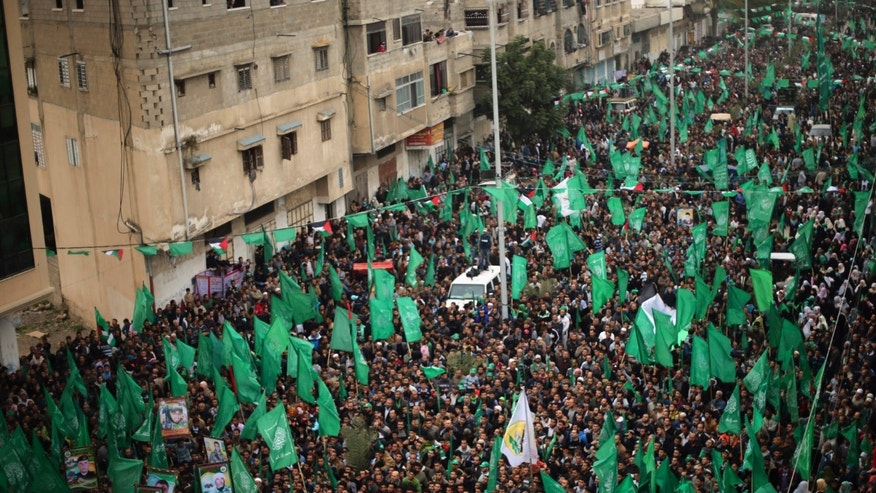 December 12, 2014 - Palestinian Hamas supporters take part in a rally ahead of the 27th anniversary of the movement founding, in Jabaliya in the northern Gaza Strip .