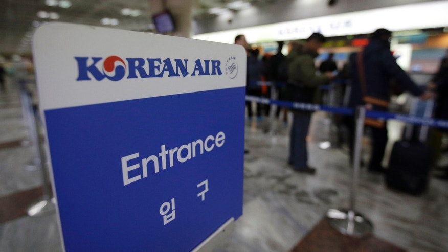 Dec. 9, 2014: Passengers wait to buy tickets at a Korean Air Lines ticketing counter at Gimpo airport.