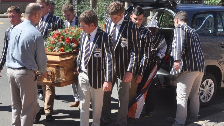 Pall bearers carry the coffin of slain Pierre Korkie, at a memorial service in Bloemfontein, South Africa, Friday, 12, 2014. Pierre Korkie, was one of two South African civilians killed in Yemen and Afghanistan. Korkie was killed on Dec. 6, during a U.S. raid on al-Qaida militants  who were holding Korkie and American hostage Luke Somers in Yemen. (AP Photo)