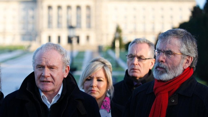 Sinn Fein's Martin McGuinness, left, Michelle O'Neill, Gerry Kelly and party president Gerry Adams, right, speak to the media at Stormont, Belfast, Northern Ireland, Friday, Dec. 12, 2014.  The British and Irish Prime Ministers left peace talks early Friday were they had been in multi-party negotiations on saving Northern Ireland's power sharing government.  (AP Photo/Peter Morrison)