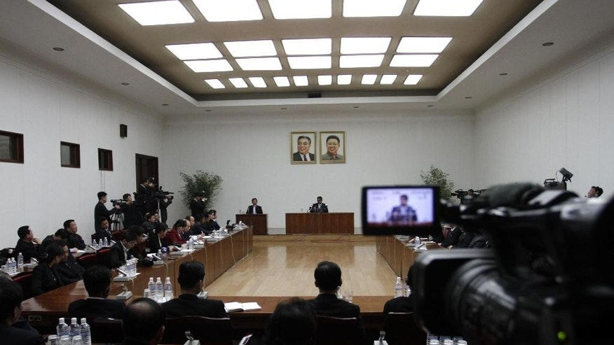 Arturo Pierre Martinez, rear center, speaks at a press conference at the People's Palace of Culture in Pyongyang, North Korea Sunday, Dec. 14, 2014. North Korea on Sunday presented to the media the American who says he illegally crossed into the country but has not been held in custody and is seeking asylum in Venezuela. Martinez, 29, of El Paso, Texas, said he entered North Korea by crossing the river border with China. Details of how and when he got into the country were not immediately clear. (AP Photo/Jon Chol Jin)