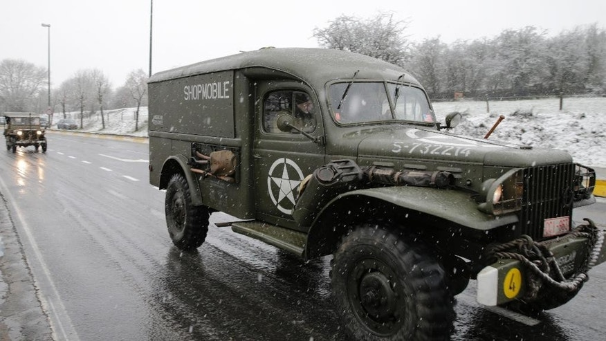 Dec. 13, 2014: A US WWII-era vehicle drives towards the Mardasson Memorial, on the 70th anniversary of the Battle of the Bulge or the Ardennes Offensive, in Bastogne, southeastern Belgium.