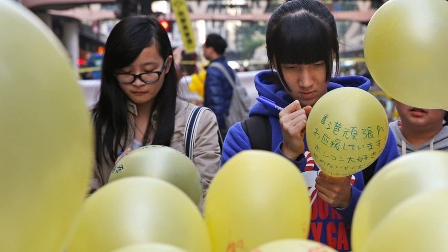 Dec. 13, 2014: People write their support messages on the balloon in the Causeway Bay shopping district, one of the occupied areas in Hong Kong.