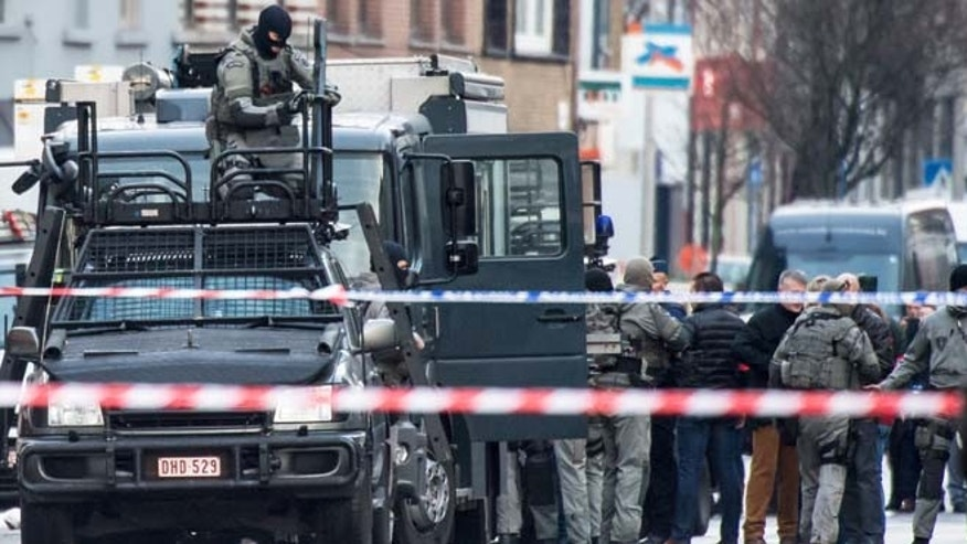 Dec. 15, 2014: A member of the special forces police installs equipment on a van, in Ghent, western Belgium. (AP)