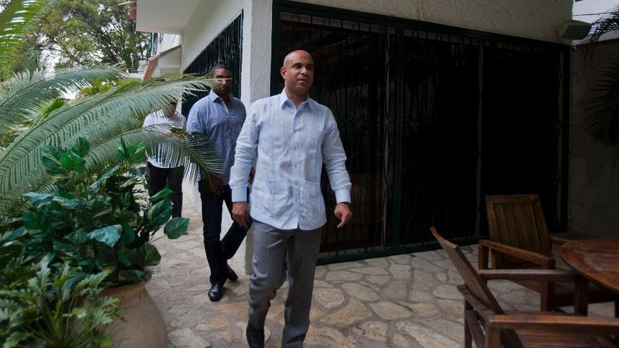 Former Haitian Prime Minister Laurent Lamothe arrives to an interview with Associated Press in Port-au-Prince, Haiti, Monday, Dec. 15, 2014. Lamothe resigned early Sunday. An independent commission had called for his resignation to end a standoff in the Senate that blocked legislation needed to hold parliamentary elections. (AP Photo/Dieu Nalio Chery)